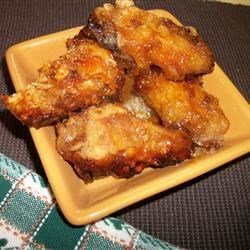 Mom's Sticky Chicken From 1972 Recipe - Sweet, sticky, spicy chicken wings are an irresistible treat. They are fried to a crispy crust, then baked in the sweet and savory sauce.