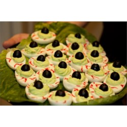 Halloween Eye of Newt Recipe - Bubble, bubble. Toil and trouble.  This appetizer is commonly known and used but, I have put my own little twist on this recipe. It is deviled eggs made to look like the eyeballs of a lizard. It a hit with the kids at my Halloween party.