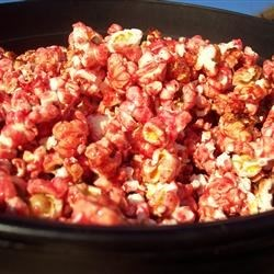 Gelatin-Flavored Popcorn Recipe - Popcorn balls in a fruit-flavored hard coating--a simple favorite.