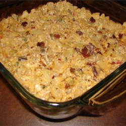 Cheesy  Potato Casserole Recipe - Hash brown potatoes are baked with processed cheese, mayonnaise and onion, topped with real bacon bits.
