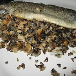 Wild Rice with Rosemary and Cashew Stuffing Recipe - Essentially, this is a rice pilaf that I have modified ever-so-slightly to be used as a stuffing for a small roasting chicken. The type of nuts, mushroom, and herbs can be varied in any number of ways.