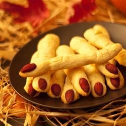 Spooky Witches' Fingers Recipe and Video - Almonds act as fingernails and red decorating gel as blood for these finger-shaped cookies that will provide a great treat for any Halloween party.