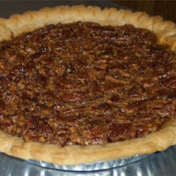 Southern Pecan Pie I Recipe and Video - Lots of sugar, dark corn syrup and pecans come together with  other delicious ingredients to create the quintessential pecan pie. Everything is stirred together in one bowl, poured into a prepared crust, and baked until this sweet pie is brown and slightly puffed.