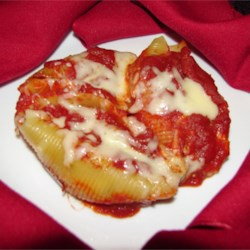 Chicken and Cheese Stuffed Jumbo Shells Recipe - Jumbo pasta shells stuffed with chicken and cheese, and baked in tomato sauce.
