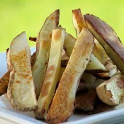 Oven Fries Recipe - Couldn't be simpler or more tasty. Cut potatoes are coated with oil, sugar, salt and red pepper flakes, and then baked. They emerge crusty and nippy on the outside and all potato on the inside.