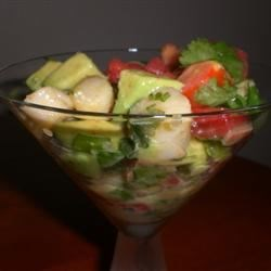 Scallop-Avocado Appetizer Recipe - This combo of low-calorie seafood and antioxidant-rich tomatoes, onions, avocado and cilantro looks and tastes great.