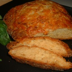 Savory Onion Bread Recipe - Cheddar cheese and sauteed onions team up wonderfully in this zesty quick bread that boasts a second helping of cheese on top.