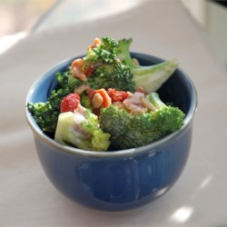Alyson's Broccoli Salad Recipe - Bacon adds a little saltiness to this broccoli salad recipe made with sunflower seeds, red onion, and raisins.