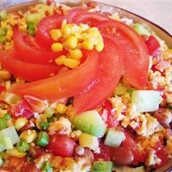 Cornbread Salad I Recipe - This is a crowd pleaser and the recipe serves twelve. What a coincidence! This is a layered salad that is fun to make and pretty served in a glass bowl. Lots of cornbread, corn, beans, green peppers, spring onions, and crumbled bacon. All layered with a creamy herbed dressing.
