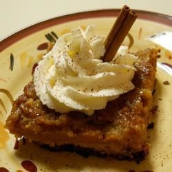 Pumpkin Pie Cake Recipe - Almost like a pumpkin pie cobbler. Rich and yummy. Try it warm from the oven with a scoop of vanilla ice cream. Originally submitted to ThanksgivingRecipe.com.