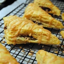 Easy Pumpkin Turnovers Recipe - Using prepared puff pastry makes these spicy pumpkin turnovers so easy to make.