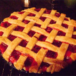 Cherry Pie III Recipe - You'll be able to tell that this is a prize-winning recipe. The crust is flaky and buttery, the cherry filling is thick and perfectly sweetened, and there's a lovely hint of almond extract.