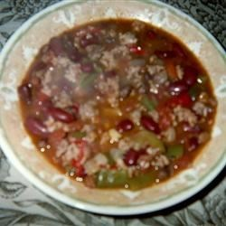 Delilah's Wicked Twelve Alarm Chili Recipe - Not for the faint of heart, this sizzling hot chili is made with 12 kinds of bell and chili peppers, from Anaheim to jalapeno, habanero and cayenne, plus ground beef, spicy pork sausage, kidney beans, chili beans, and black-eyed peas.