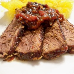 Cola Pot Roast I Recipe - Tomatoes, cola, and spaghetti sauce mix are the starring ingredients of this pot roast, which may be cooked in advance and reheated.
