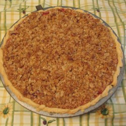 Cranberry Apple Pie III Recipe - Fresh cranberries, maple syrup, brown sugar, and walnuts spice up this delicious crumb-topped apple pie.
