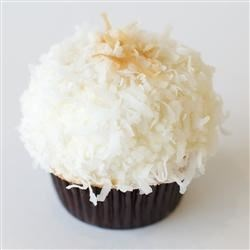 Coconut Frosting and Filling Recipe - This mixture of sour cream, sugar, coconut, and whipped cream dessert topping is a perfect frosting for a white layer cake!