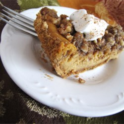 Pumpkin Pecan Cheesecake Recipe - A new addition to our holiday menu.  Combines pumpkin, pecans, and cheesecake. Originally submitted to ThanksgivingRecipe.com.