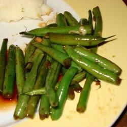 Dad's Pan-Fried Green Beans Recipe - Once upon a time, Dad received a similar recipe with a bundle of fresh green beans. He made the recipe once and then lost the card. After many attempts to recreate that flavor, he declares that this, his own recipe, is even better!