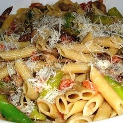 Penne with Asparagus and Mushrooms Recipe - Fresh sauteed vegetables are combined with a fresh creamy tomato sauce to create this delicious, easy to make pasta dish. Serve with grated cheese.