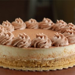 Tiramisu Cheesecake Recipe - With a crust made of ladyfinger crumbs and a filling made with cream cheese, mascarpone, and espresso, this cheesecake combines the flavors of tiramisu with the richness of a New York-style cheesecake. Top with grated semisweet chocolate just before serving.