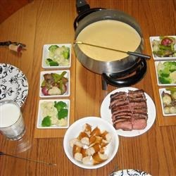Best Formula Three-Cheese Fondue Recipe - We tried a couple of recipes; this was voted the best!  The Gruyere gives a very sweet and nutty flavour to the fondue, the sharp Cheddar makes it tangy, and the Emmentaler blends it all.  Cooking the flour first helps the mixture not to be so pasty and powdery.