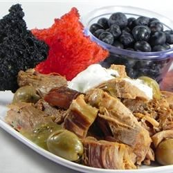 Don Struble's Puerto Rican Pork Roast Recipe - First you marinade it in hot pepper and Worcestershire sauce, then you punch it up with garlic and olives and more hot pepper sauce, then you add wedges of pepperoni for an unexpected jolt of flavoring.