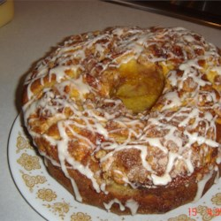 Easy Apple Coffee Cake Recipe - An easy cake mix cake with a beautiful layer of apples in the middle. Serve warm with a scoop of ice cream.