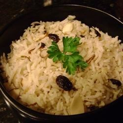 Rice with Almonds and Raisins Recipe - The rice is cooked in chicken broth instead of water to give it a good flavor. This dish would complement any meat, poultry, or fish. Delicious!