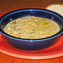 Slow Cooker Corn Chowder Recipe - A can of evaporated milk finishes this recipe for corn chowder with ham, onion, celery and potato in a chicken bouillon soup base.  Allow 8 hours cooking time.