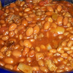 Texas-Style Baked Beans Recipe - Not your usual baked beans! Green chiles and hot pepper sauce give zest to these eat-'em up sweet-and-hot baked beans.