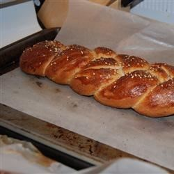 Everything Challah Recipe - Inspired by the toppings on an everything bagel, this recipe makes 2 beautiful, braided loaves glazed with shiny egg glaze and topped with sprinkles of dried onion, garlic, poppy seeds, sesame seeds, and a little kosher salt if desired.