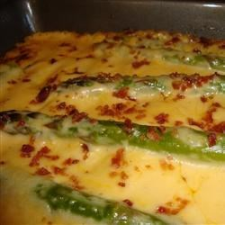 Thanksgiving Asparagus Casserole Recipe - Asparagus, Cheddar cheese, and slivered almonds combine to create a very elegant side dish for Thanksgiving!