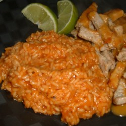 Simple Mexican Rice Recipe - A very simple tomato Mexican rice recipe.  I can have this in the oven and cooking in one set of ads on the TV. If you don't have chicken stock, use hot water and chicken bouillon.