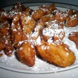 Pumpkin Funnel Cakes Recipe - This traditional Pennsylvania Dutch treat is flavored with pumpkin puree and pumpkin pie spice, cooked in deep fat until crisp and golden, then dusted with confectioners' sugar.