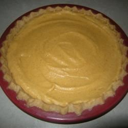Pumpkin Chiffon Pie I Recipe - Pull out the double boiler, because you'll need it to turn egg yolks, sugar, pumpkin puree, milk and spices into a thick, creamy and delicious filling for this wonderful pie. When all of the ingredients are combined, gelatin and beaten egg whites are stirred and folded in to make the chiffon part. Chill and serve with a dusting of nutmeg.