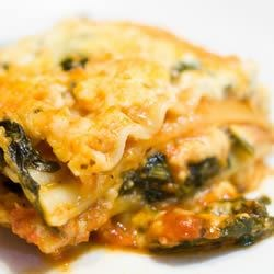 Spinach Lasagna II Recipe - Use uncooked lasagna noodles to add to the easy preparation of this tasty casserole! Tomato sauce and paste are enhanced with spaghetti sauce mix, and the creamy layers are packed with ricotta, mozzarella, cottage cheese, spinach and Parmesan.