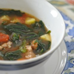 Italian Sausage Soup Recipe and Video - This soup is easy to put together, and the flavor of the spicy sausage is balanced nicely by Great Northern beans, zucchini, fresh spinach, and carrots.  Makes a delicious winter supper.
