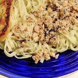 Linguine with Clam Sauce Recipe - For this quick and easy clam sauce, toss canned clams in a pan with butter, oil, garlic, parsley, basil and pepper. Serve hot over linguine.