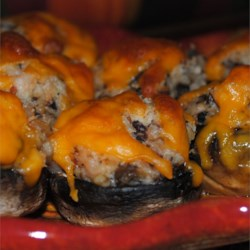 Shrimp Stuffed Mushrooms Recipe - Mushrooms are stuffed with a tasty bacon flavored shrimp mixture, then topped with Cheddar cheese.