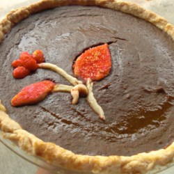 Pumpkin Pie III Recipe - This scrumptious pie has brown sugar and molasses blended into the filling, along with evaporated milk, pumpkin puree, eggs and yummy spices. So when it bakes, the pie is extra sweet and the filling turns a beautiful dark color. It 's especially nice served with freshly whipped cream sprinkled with candied ginger.