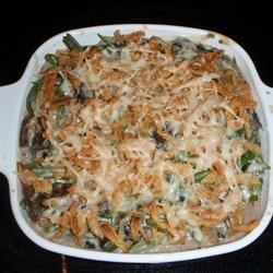 Absolutely Delicious Green Bean Casserole from Scratch Recipe - No cans here! Fresh mushrooms, onion, and herbs with frozen green beans, sour cream, and cheddar cheese make this a delightfully tasty twist on the traditional casserole. I developed this recipe, longing for a 'no cans' version of the classic dish. I made this one year for my husband's family at Christmas time, and now they ask for it every year! My husband asks me to make it for dinner throughout the year.