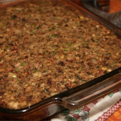 Sausage, Bacon, Apple and Cornbread Stuffing Recipe - A winner at any Thanksgiving dinner, sausage, bacon, apple chunks, mushrooms, celery, onions tossed with cornbread and bread cubes, make this savory stuffing a family favorite.