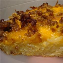 Hash Brown and Egg Casserole Recipe - Classic breakfast favorites come together in this layered hash brown casserole with eggs, cheese, and sausage.
