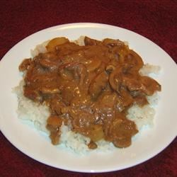 Slow Cooker Beef and Mushrooms Recipe - This hearty beef and mushroom stew is really easy to make with the help of your crock pot.  Serve with lots of hot white rice to catch the gravy.