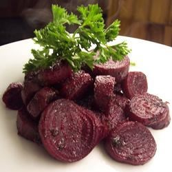 Roasted Pesto Beets Recipe - Red beets are boiled until just tender,then sliced and smothered in pesto before being roasted in the oven.