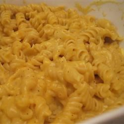Bev's Mac and Cheese Recipe - Use your microwave to cook up a simple, creamy sauce of milk, flour, butter and shredded Cheddar cheese to pour over cooked macaroni. Try experimenting with different varieties of cheese to make this homey dish your own.