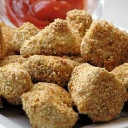 Herbed Chicken Nuggets Recipe and Video - These homemade chicken nuggets are baked, not fried, and get their nutty flavor from wheat germ.