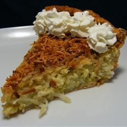 Coconut Custard Pie II Recipe - The coconut custard filling in this pie is sensational, but the real surprise is the coconut streusel topping that's sprinkled on just before it's run under the broiler and served.