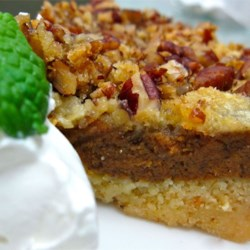 Pumpkin Crumb Cake Recipe - A boxed yellow cake mix is used to create a short crust and crumble topping for this cake with a pumpkin custard filling.