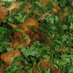 Chicken Karhaai Recipe - Chicken is simmered with tomato and hot chili peppers for this popular Indian dish.